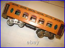 Lionel original orange pre war std ga passenger car #18. Has some restoration